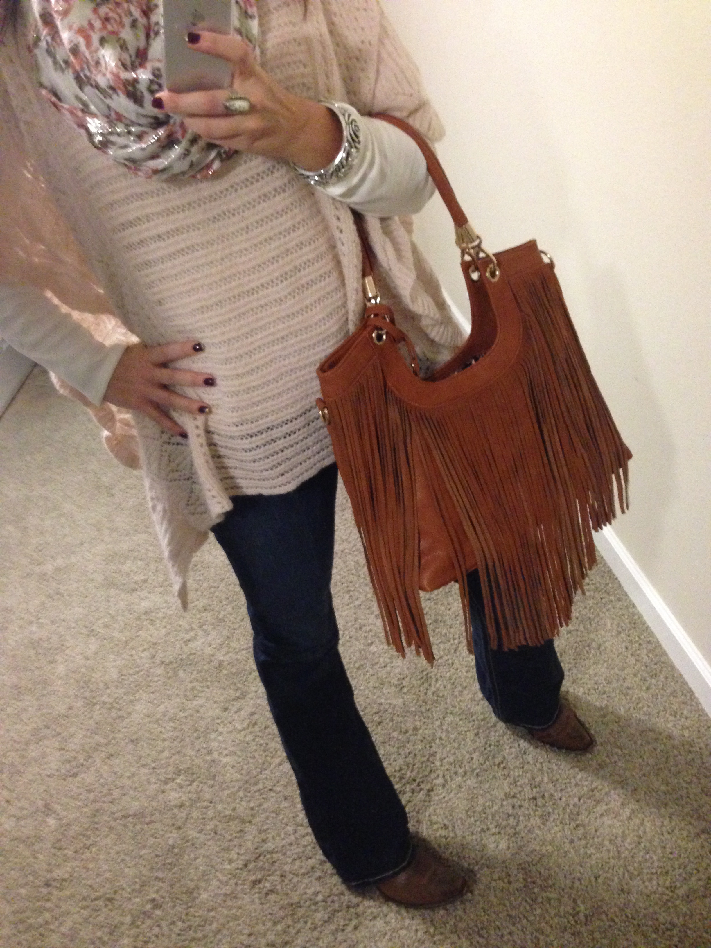 Sweater: Free People; Scarf: Charming Charlie; Shirt: Nordstrom; Boots: Old Gringo c/o Cowboy Cool; Handbag: c/o Bijuju Handbags; Watch: Michele; Bracelet: c/o Lisa Leonard; Bracelet: Stella and Dot; Ring: Euro Art Jewelers