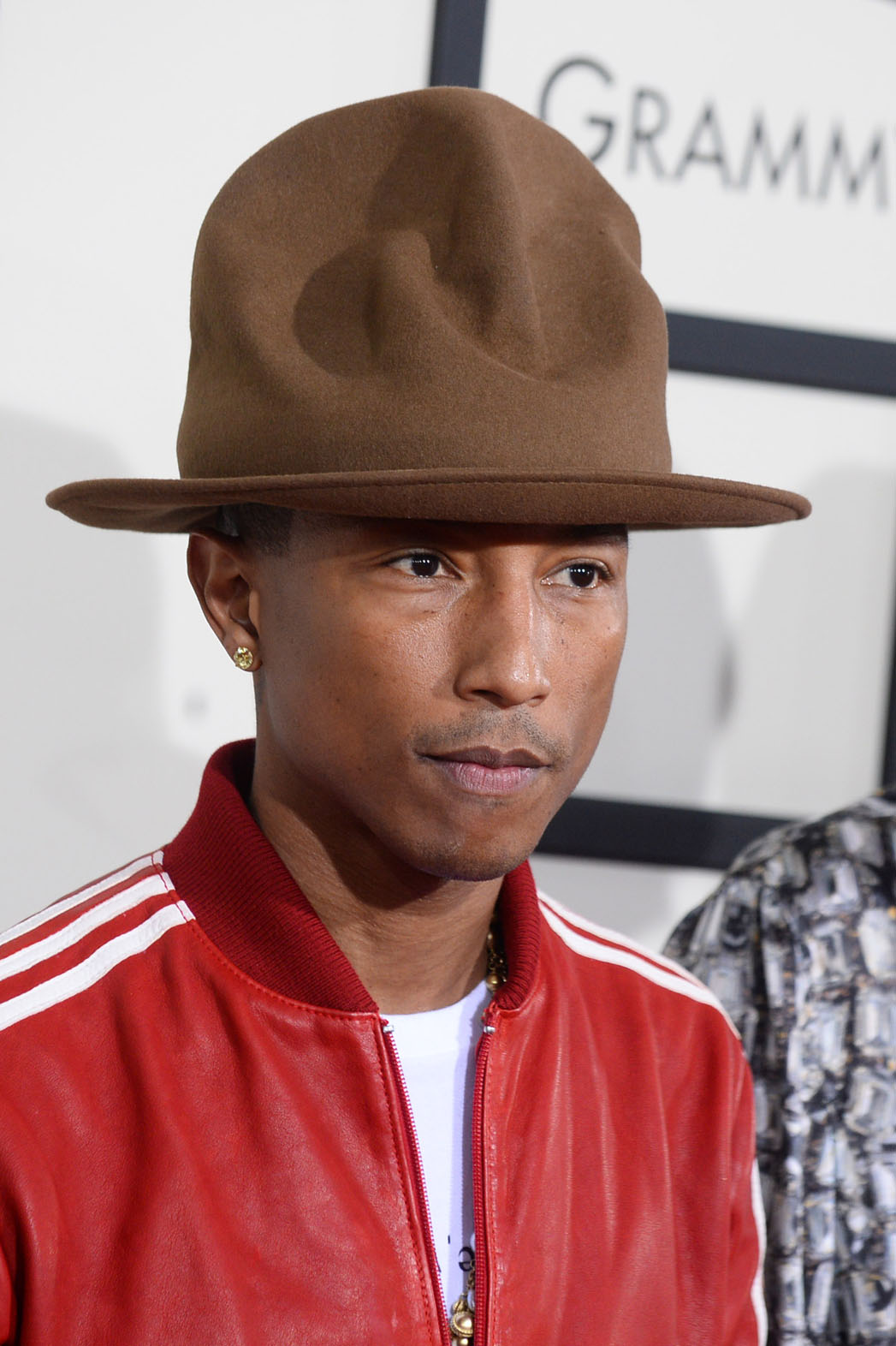 What's with the horrible hat Pharrell?  UGH.
