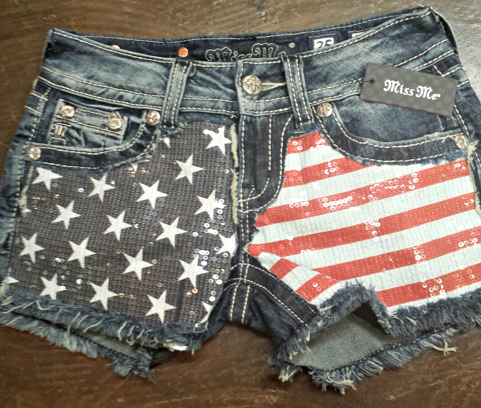 Miss Me shorts are the perfect staple for summer, and with a sequined flag pattern you can't go wrong.    Click the photo for details.