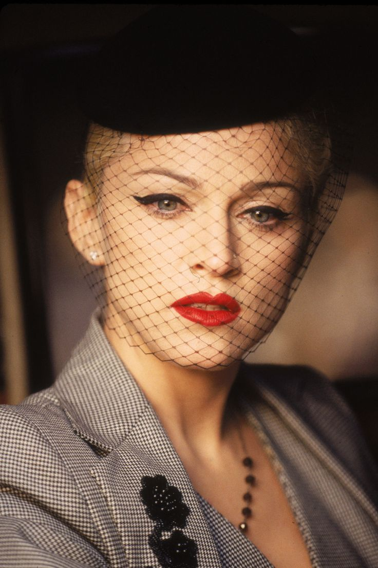 The Material Girl shows her Evita red