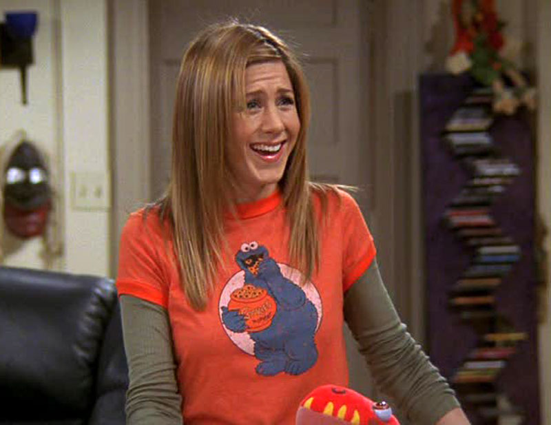 1990's -- T-Shirts Over Long-Sleeved Shirts. I would follow Rachel Green if she jumped off a bridge but this I cannot find the logic in or get behind at all.