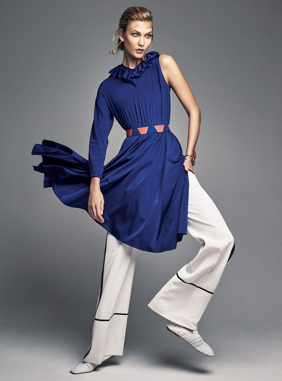 On Karlie Kloss: Vetements dress, $1,990, for information: bergdorfgoodman.com, Bergdorf Goodman, NYC, 212.753.7300; Tory Sport pants, $350, for information: torysport.com, Tory Sport, NYC, 212.777.2226; Proenza Schouler belt, price upon request, for information: proenzaschouler.com, Proenza Schouler, NYC, 212.420.7300; J.W.Anderson heels, $1,050, j-w-anderson.com; Céline earrings, price upon request, for information: celine.com; Céline bracelet, $590, celine.com (worn throughout); David Yurman bracelet, $8,500, davidyurman.com (worn throughout); Dinosaur Designs cuff, $310, dinosaurdesigns.com (worn throughout) Fashion Editor: Alex Harrington Photographed by Patrick Demarchelier, Vogue, January 2017